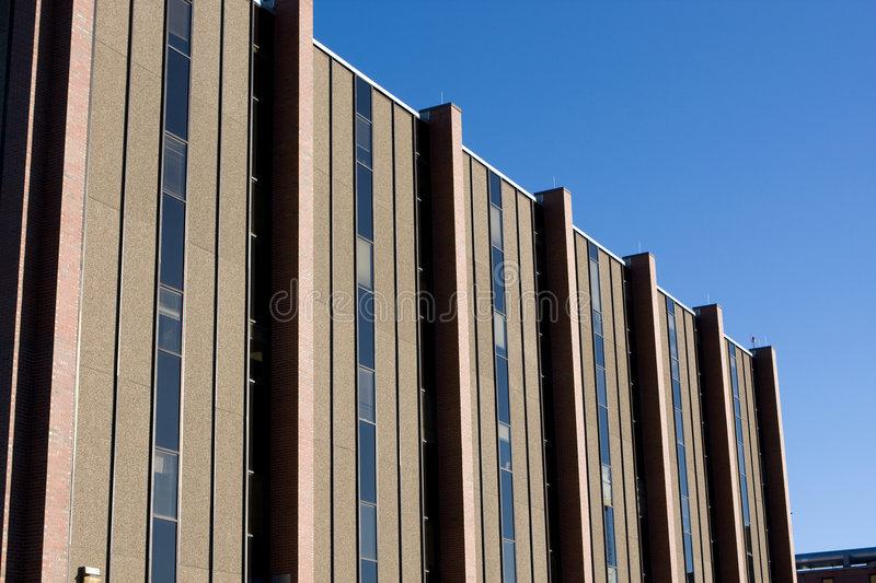 Modern Hospital Building. A modern hospital building is shown against a blue sky royalty free stock photo