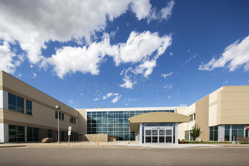 Modern Hospital Building Against Sky. Exterior of modern hospital building against sky on sunny day stock photos