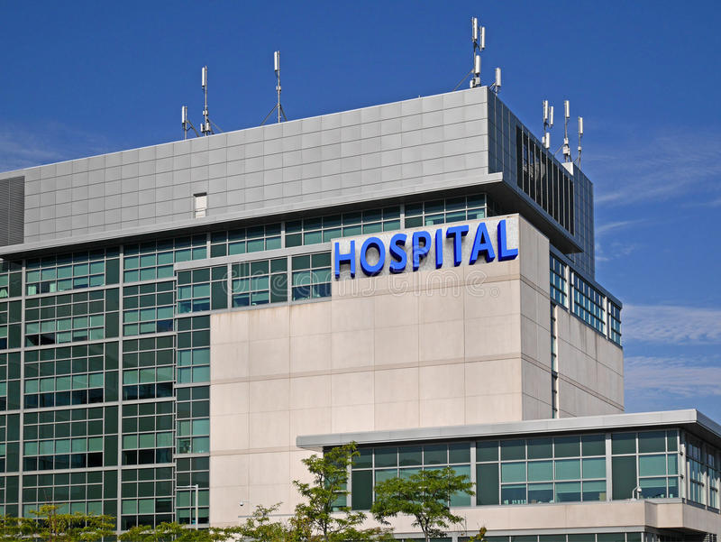 Modern hospital style building. Close up view of modern hospital building royalty free stock photo
