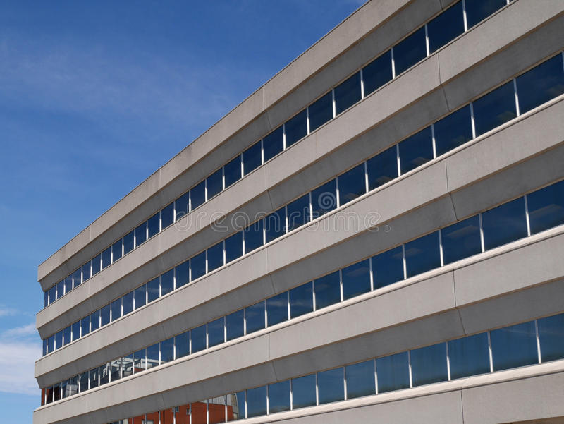 Modern hospital style building. Close up view of modern hospital building royalty free stock image