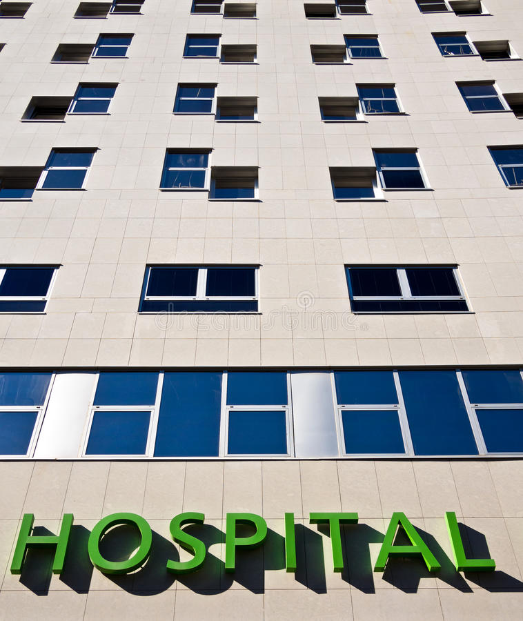 Modern Hospital Building - Medical Services. Modern hospital building providing medical aid and healthcare services stock photo