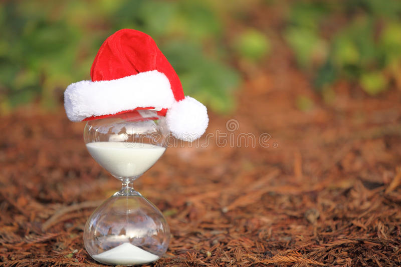 Modern Hourglass with space for text. Christmas countdown. Modern Hourglass -- sand trickling through the bulbs of a crystal sand glass stock image
