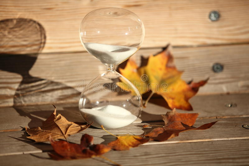 Modern Hourglass. symbol of time. countdown. Modern Hourglass -- sand trickling through the bulbs of a crystal sand glass. symbol of time. countdown. Time royalty free stock photo
