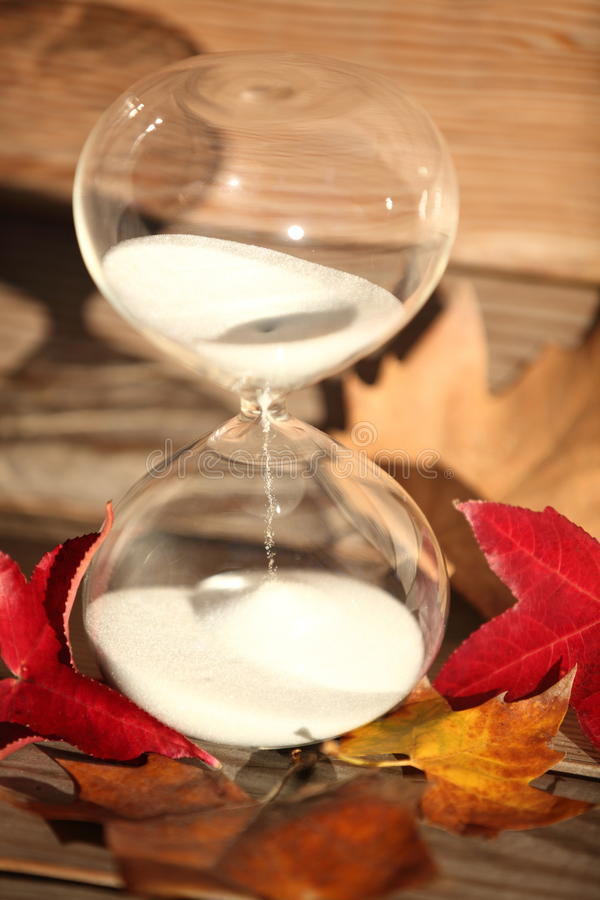 Modern Hourglass. symbol of time. countdown. Modern Hourglass -- sand trickling through the bulbs of a crystal sand glass. symbol of time. countdown. Time stock photos