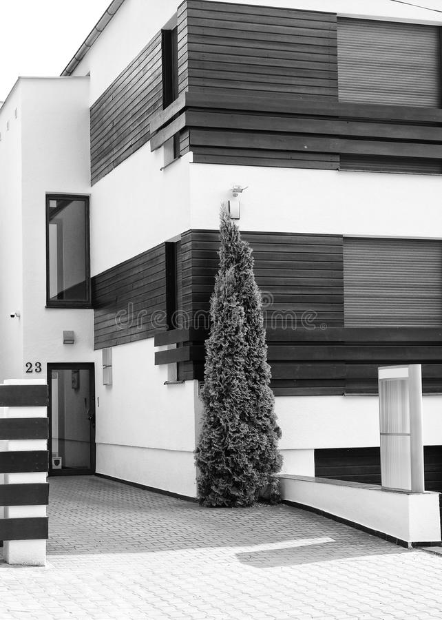 Modern house architecture black and white. A modern house with wooden elements, contemporary architecture in black and white stock images