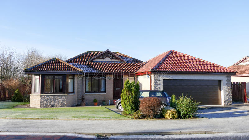 Modern house - bungalow. Modern big house with garage and car in the front - bangalow royalty free stock photography