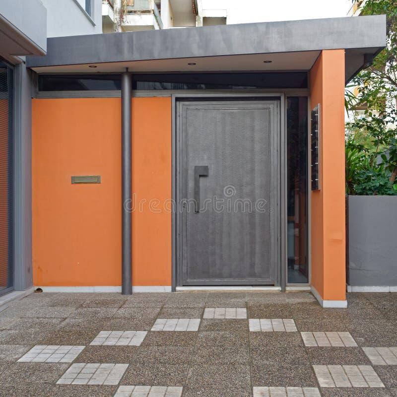 Modern house colorful entrance metallic grey door stock photo