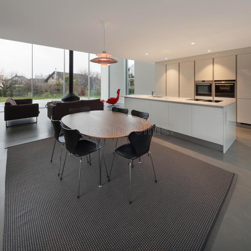 Modern house, dining room. Beautiful interiors of a modern house, dining room royalty free stock photography