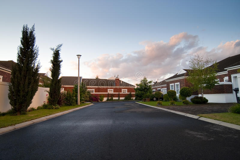 Modern house with dramatic clouds stock image