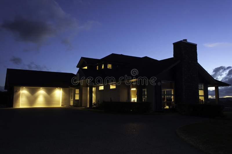 Modern house exterior with lighting at night stock photo for Modern house at night