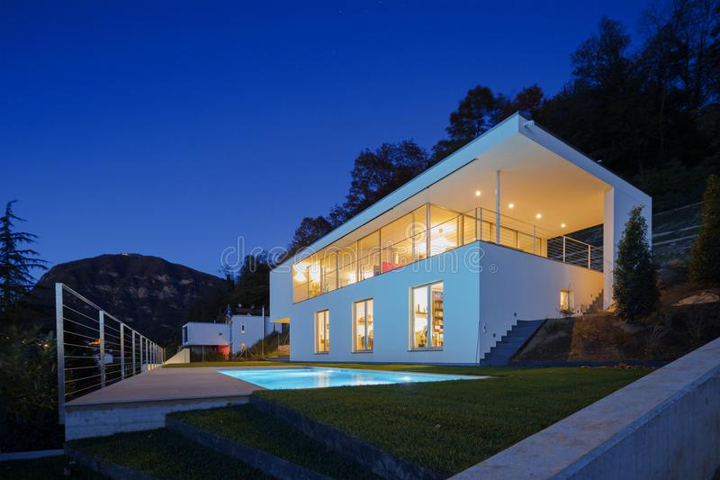 Modern villa, exterior in the night, lights on royalty free stock image