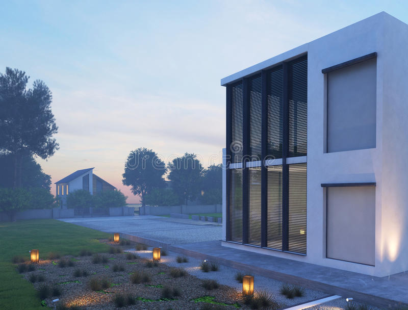 Modern house exterior with outdoor lighting at twilight. Picture of Modern house exterior with outdoor lighting at twilight royalty free stock photo