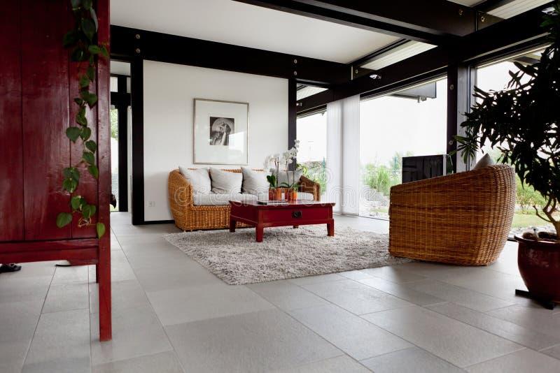 Modern house, living-room stock photos
