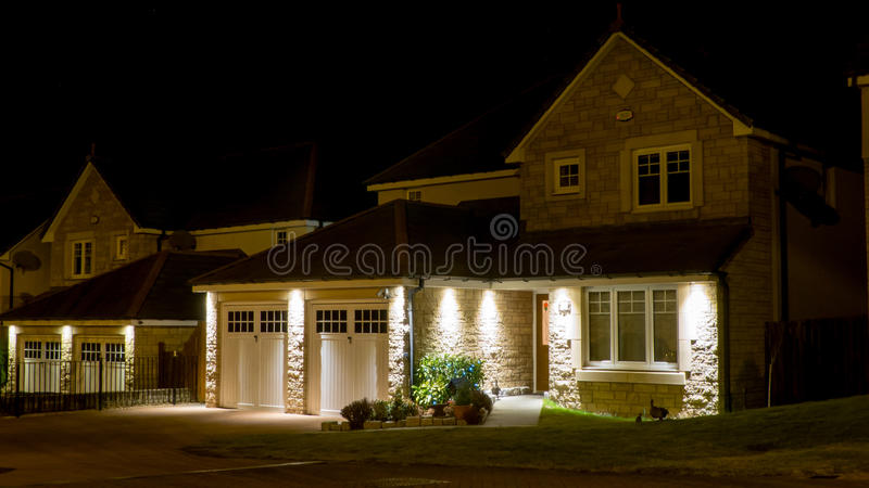 Modern house at night stock photography