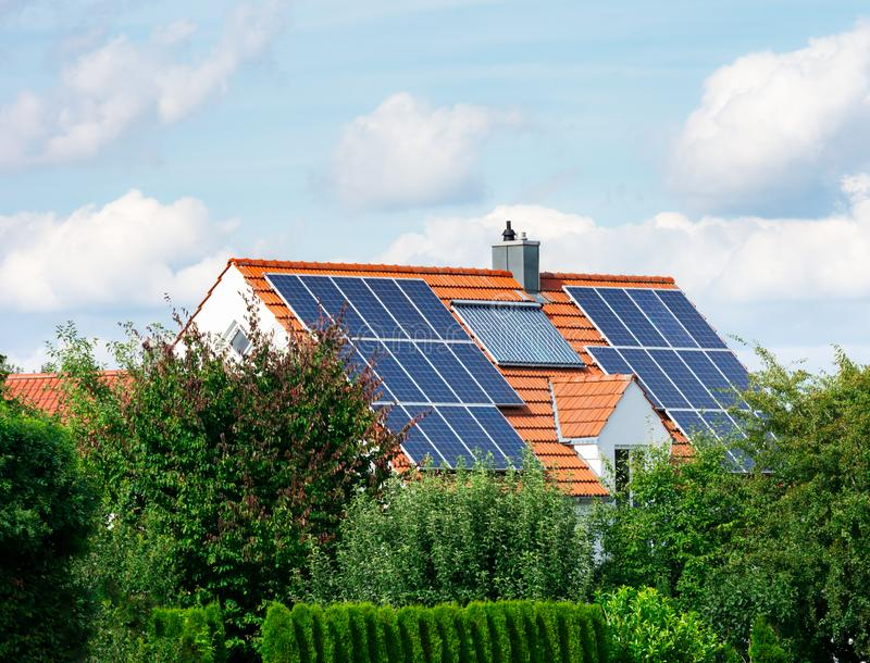 Modern House with Photovoltaic and Solar Heating System royalty free stock photo