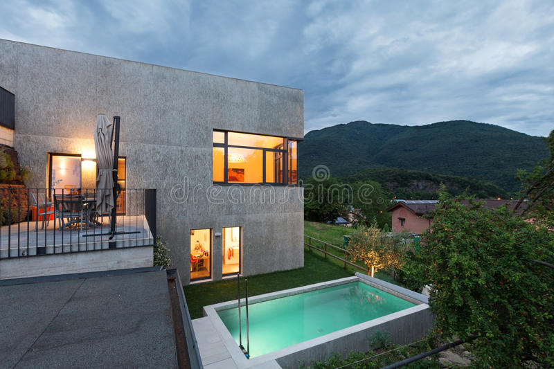 Modern house with pool stock photography