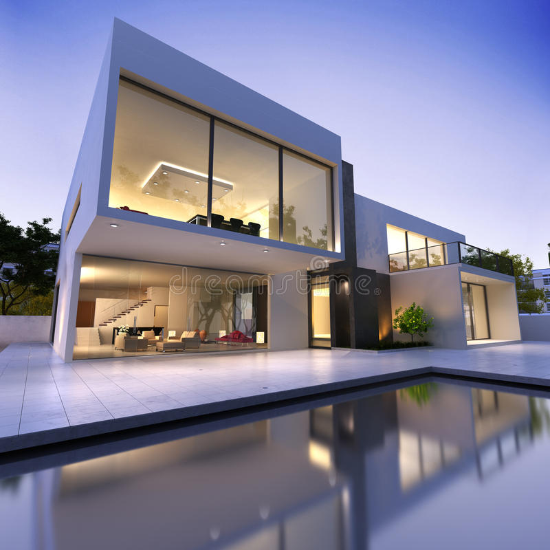 Modern house with pool. External view of a modern house with pool at dusk royalty free stock photo