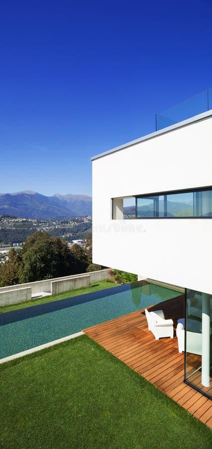 Modern house, with pool. Modern house with pool and garden, summer time stock photo