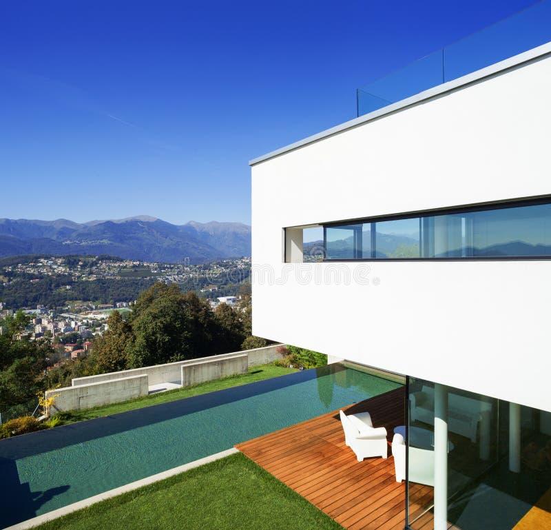 Modern house, with pool. Modern house with pool and garden, summer time stock images