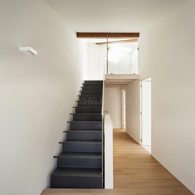 Modern house, staircase. Beautiful modern loft, view of the staircase royalty free stock photography
