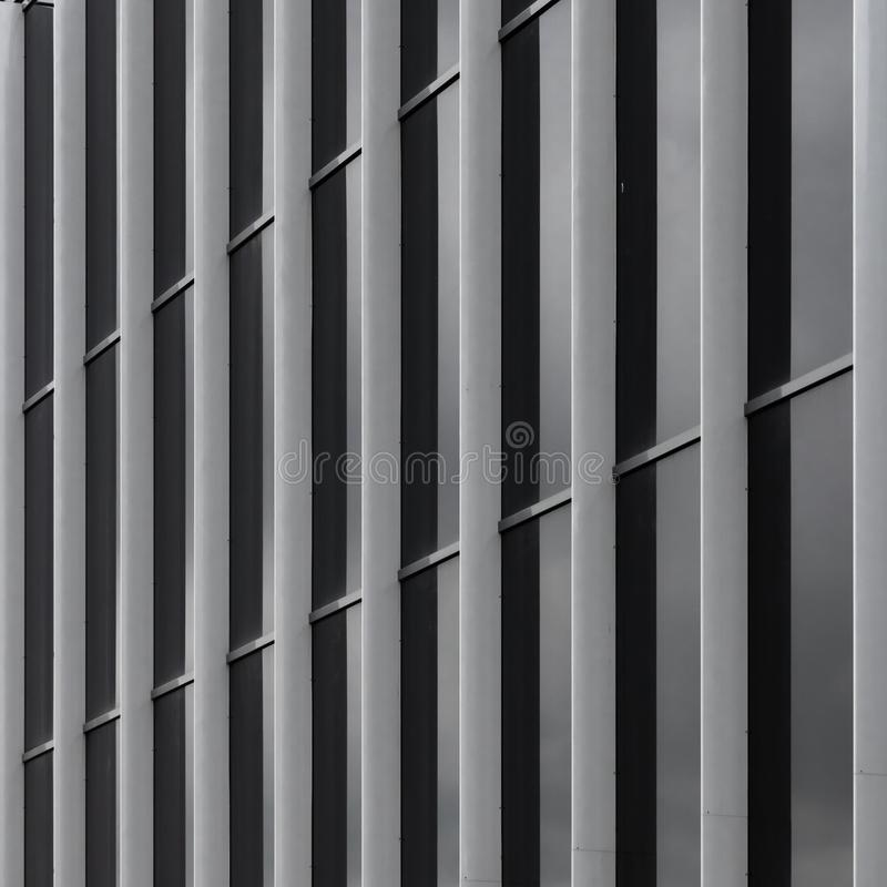 Modern house wall, geometric lines and patterns. Metal details of building`s facade abstract background with vertical stripes stock photos