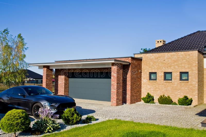 Modern house yard with garage and expensive car stock photo