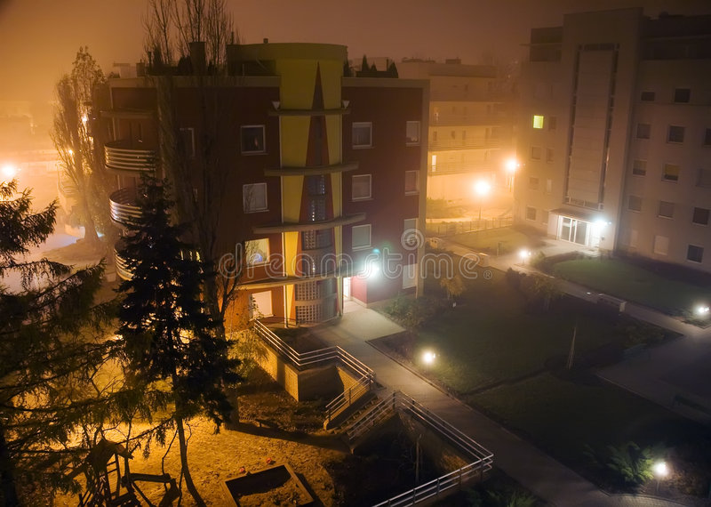 Modern houses in foggy night royalty free stock images