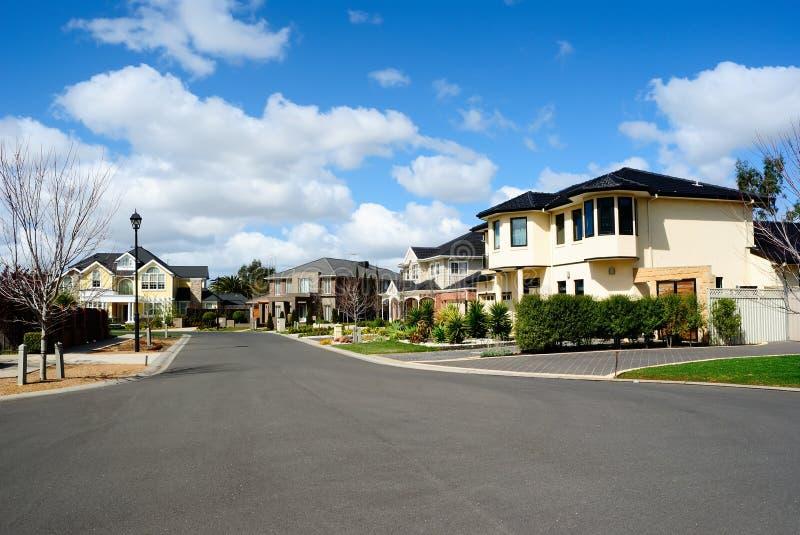 Modern houses in a suburban neighborhood stock images