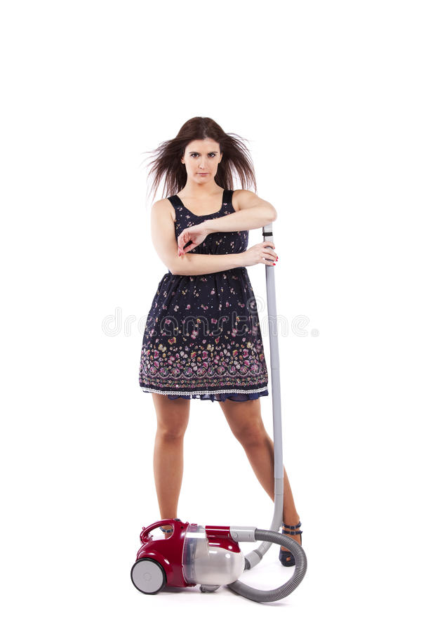 Modern housewife. Modern and young housewife posing with the vacuum cleaner (isolated on white stock image