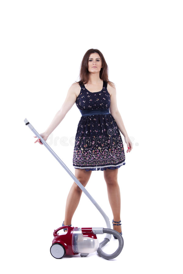 Modern housewife. Modern and young housewife posing with the vacuum cleaner (isolated on white royalty free stock photos
