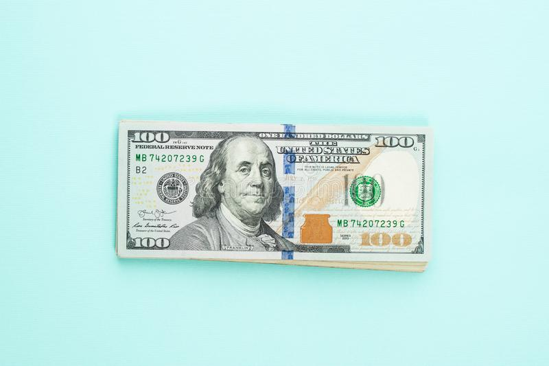 Modern hundred us dollar bills on blue background. Financial USA money banknote.  stock photography