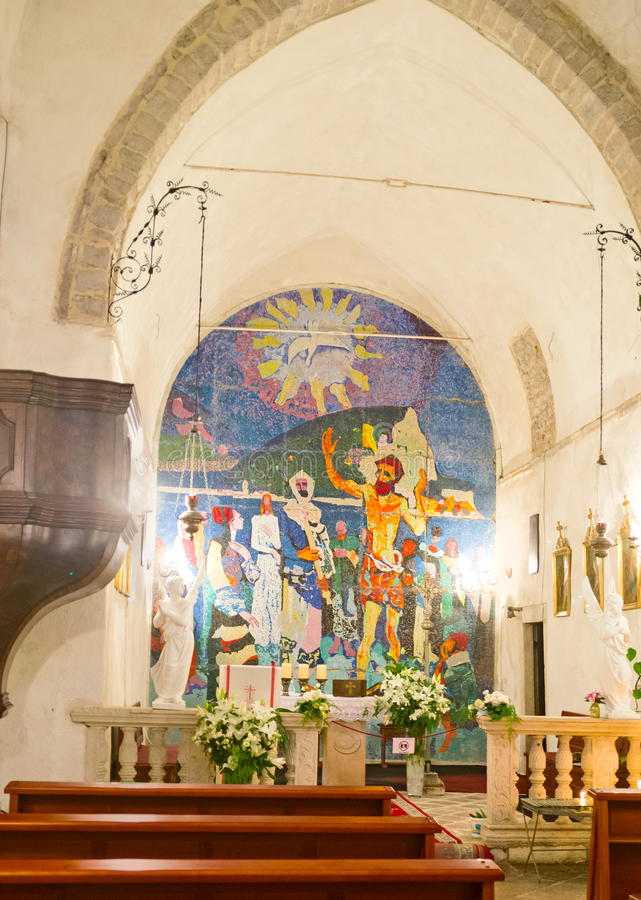 The modern icon in medieval church. BUDVA, MONTENEGRO - JULY 15, 2014: The modern mosaic icon at the altar in Holy Trinity Church, on July 15 in Budva stock images