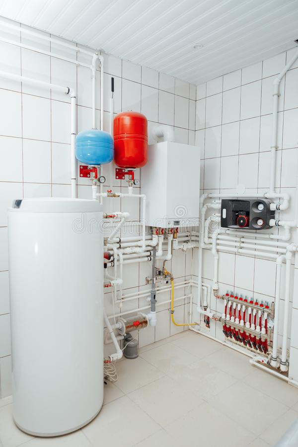 Modern independent heating system in boiler room. Closeup view royalty free stock photos