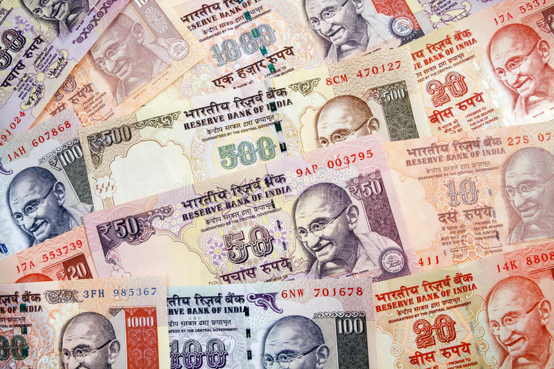 Modern Indian Rupees Paper Currency Arrangement. An arrangement of Indian Rupees paper currency with all of the current designs of each of the denominations stock photo