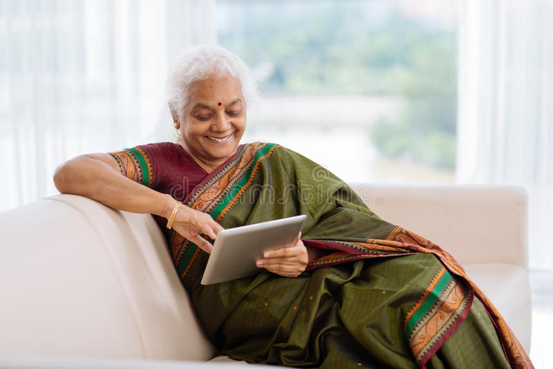 Modern Indian Woman Stock Photo Image 48304544 : modern indian woman national dress sitting sofa using tablet 48304544 from www.dreamstime.com size 800 x 534 jpeg 49kB