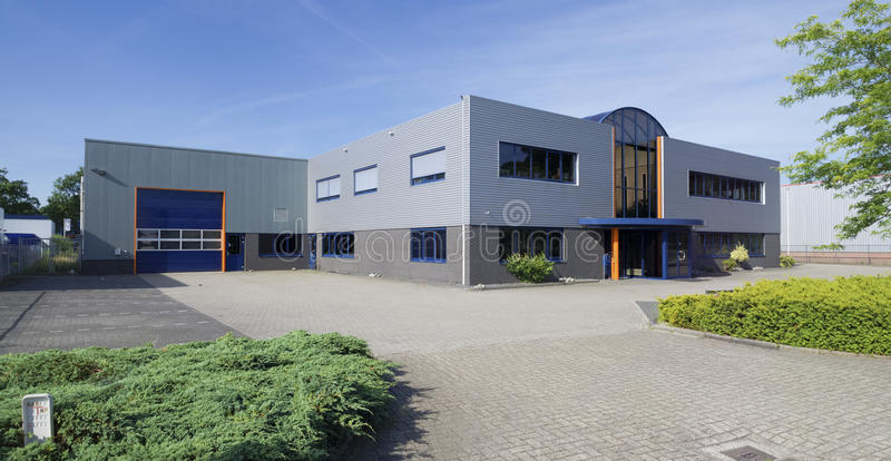 Modern industrial building. Exterior of a modern warehouse building with office royalty free stock image