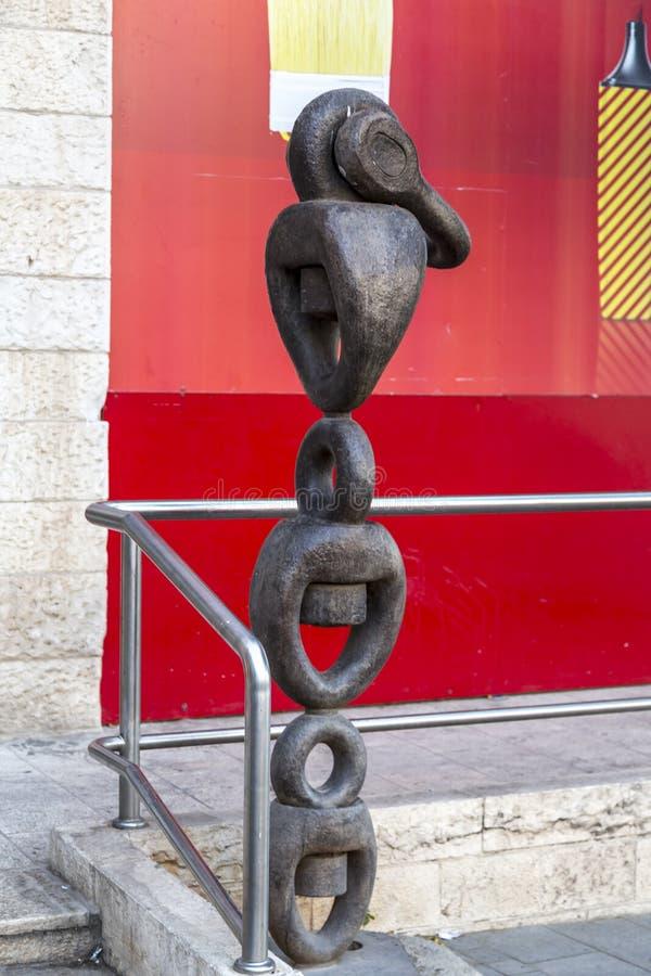 Modern industrial chain shaped metal sculpture in HaDavidka Square, Jerusalem, Israel stock image