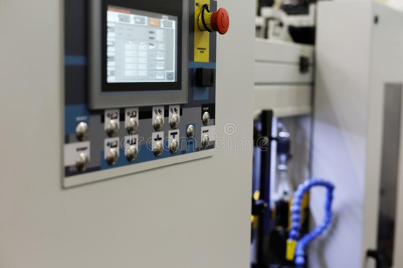Modern industrial equipment with CNC control panel. On the foreground. Selective focus royalty free stock image