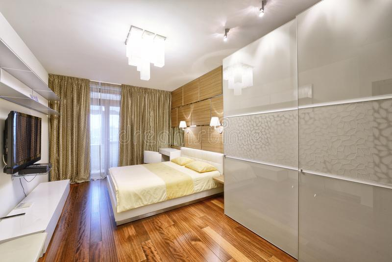 Modern interior of a bedroom in the new house. Designer modern renovation in a luxury house. Stylish bedroom interior with double bed stock image