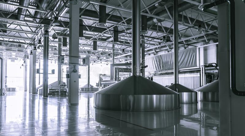 Modern interior of a brewery mash vats metal containers. Modern interior of a beer factory mash vats metal containers royalty free stock photography