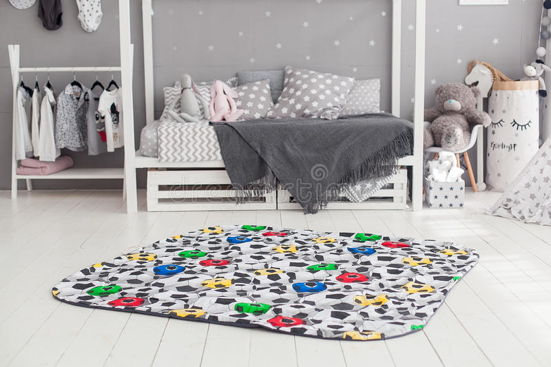 Modern interior of the child`s bedroom with carpet in front royalty free stock images