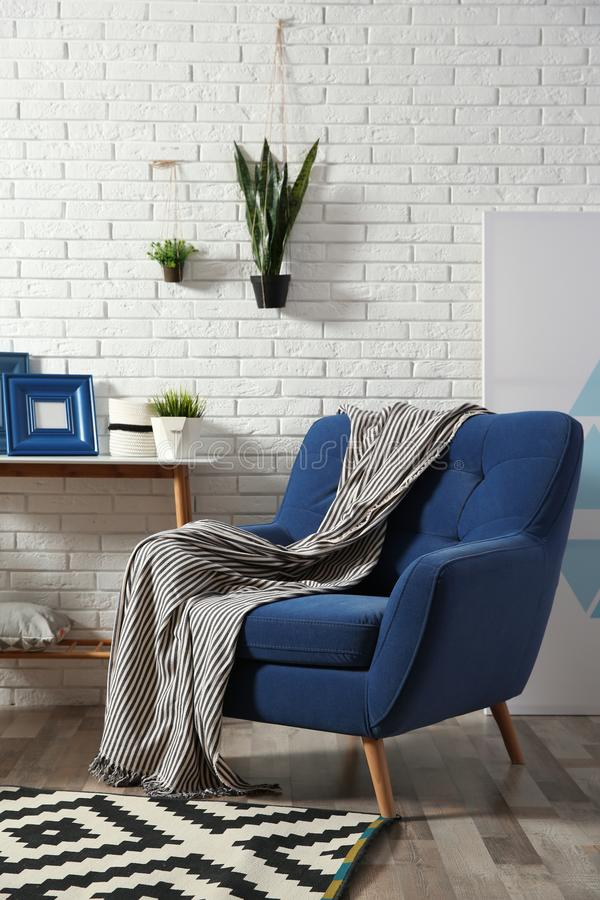 Modern Interior With Cozy Armchair And Table Stock Photo ...