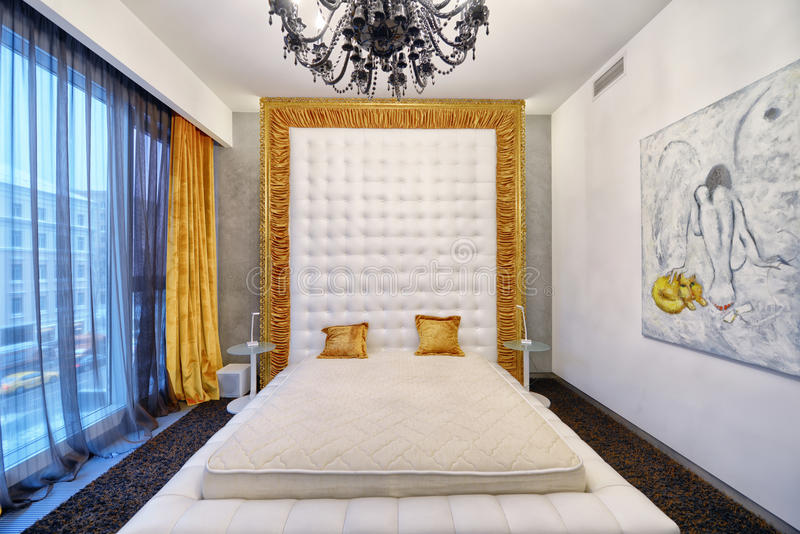 Modern interior design bedroom town real estate. Russia, Moscow - modern designer renovation in a luxury building. Stylish bedroom interior with double bed stock photography