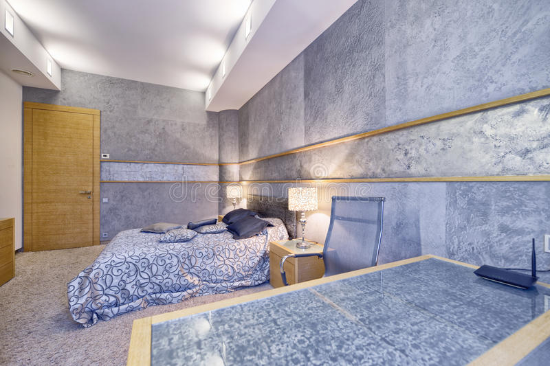 Modern interior design bedroom town real estate. Russia, Moscow - modern designer renovation in a luxury building. Stylish bedroom interior with double bed royalty free stock image
