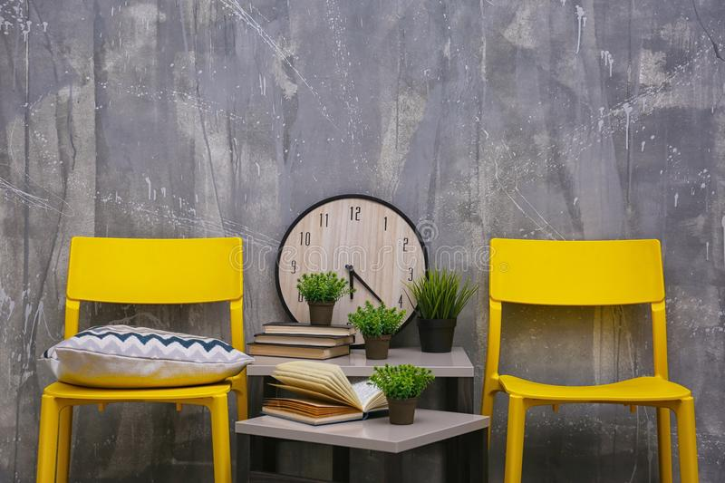 Modern interior design with yellow chairs and little table royalty free stock photo