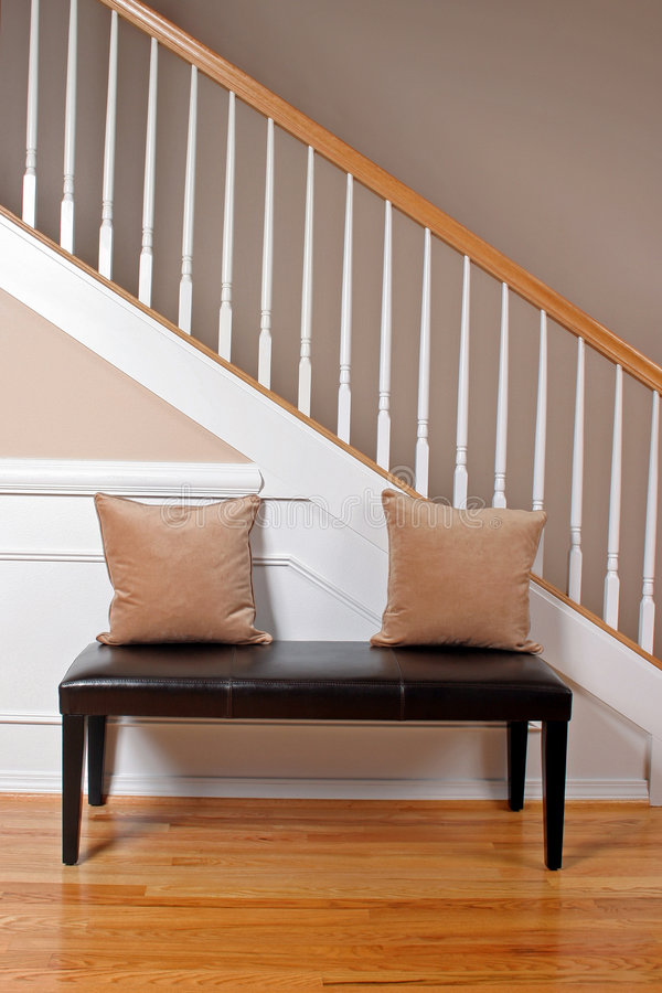 Modern Interior Entryway. The interior entry of a newer home with a leather bench royalty free stock image
