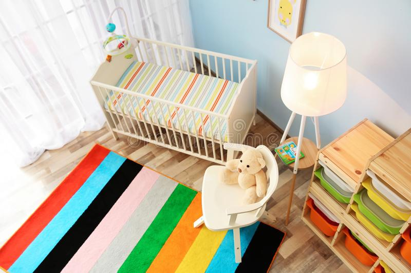 Modern interior of light cozy baby room with crib. View from above stock photos