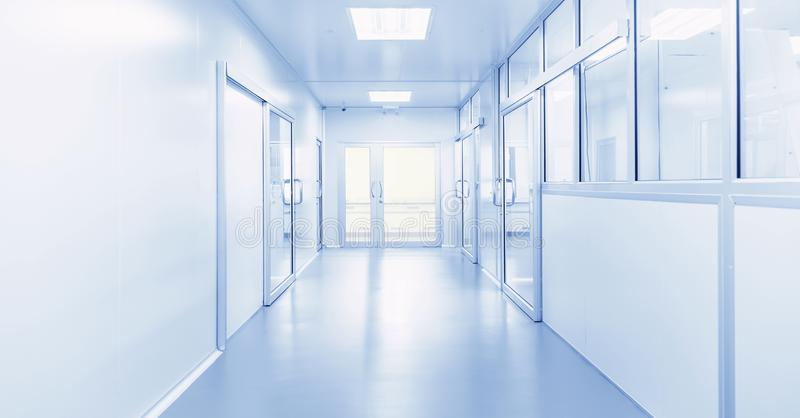 Modern interior of science laboratory or factory. Modern interior of science laboratory or industry factory background with gateway and bright fluorescent light stock photos