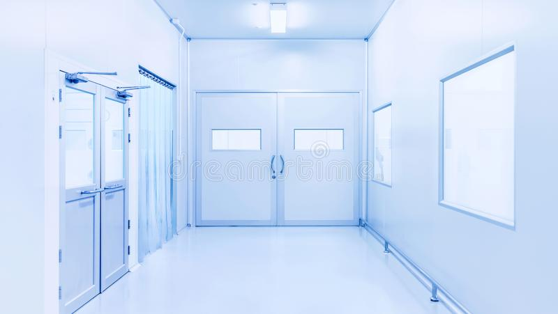 Modern interior of science laboratory or industry factory. Background with gateway and bright fluorescent light royalty free stock photo