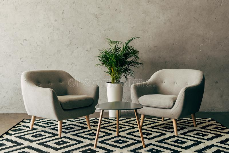 modern interior with vintage furniture in loft style with concrete wall royalty free stock image